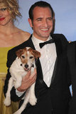 In the press room, Uggie gets a snuggle from costar (and Best Actor in a Comedy or Musical winner) Jean Dujardin.