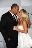Kendra Wilkinson and hubby Hank Baskett arrive at the NBC Universal party with a kiss.
