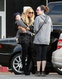 Rachel Zoe carrying Skyler.