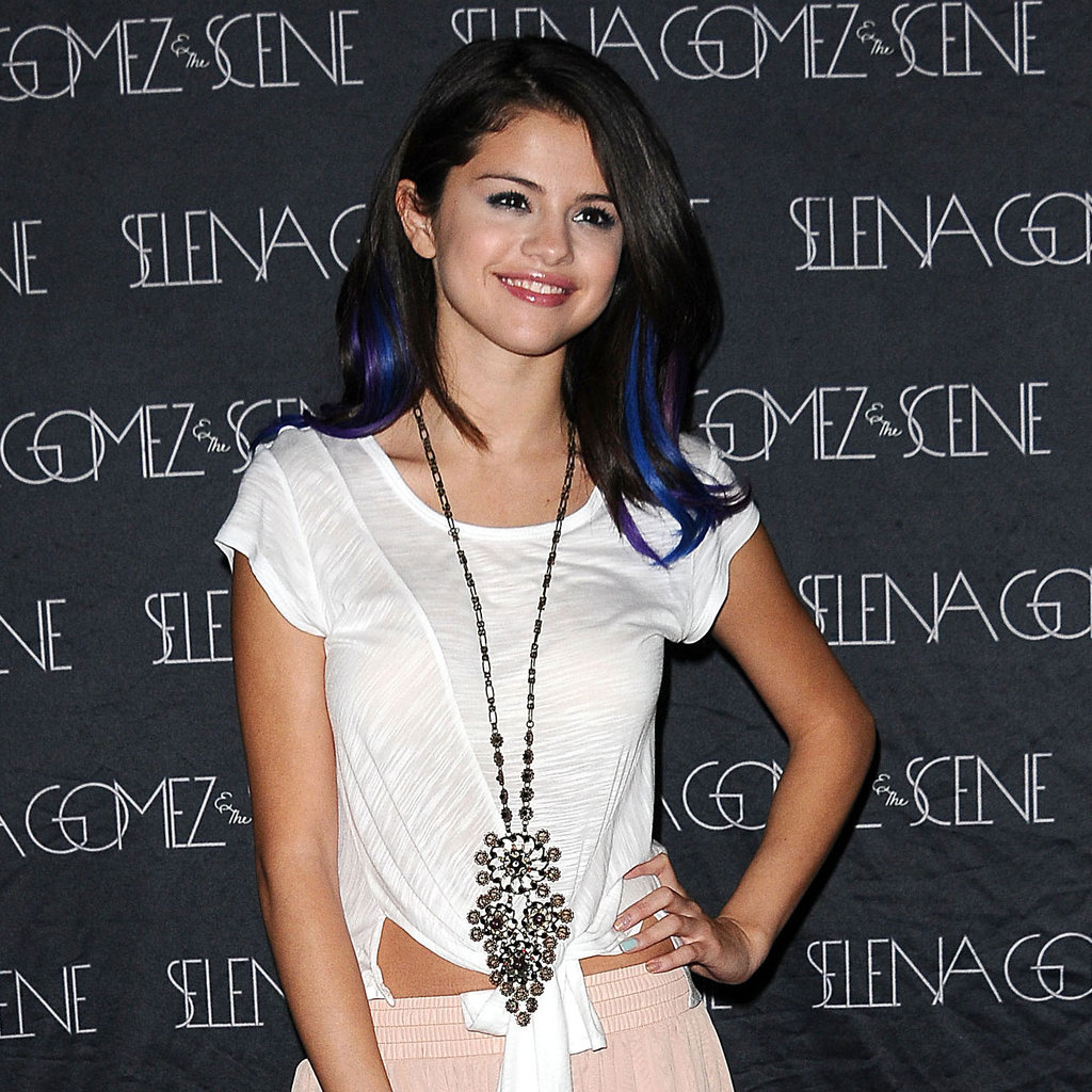 Selena topped off her outfit with a large statement necklace.