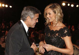 Stacy Keibler and nominee George Clooney shared a laugh.