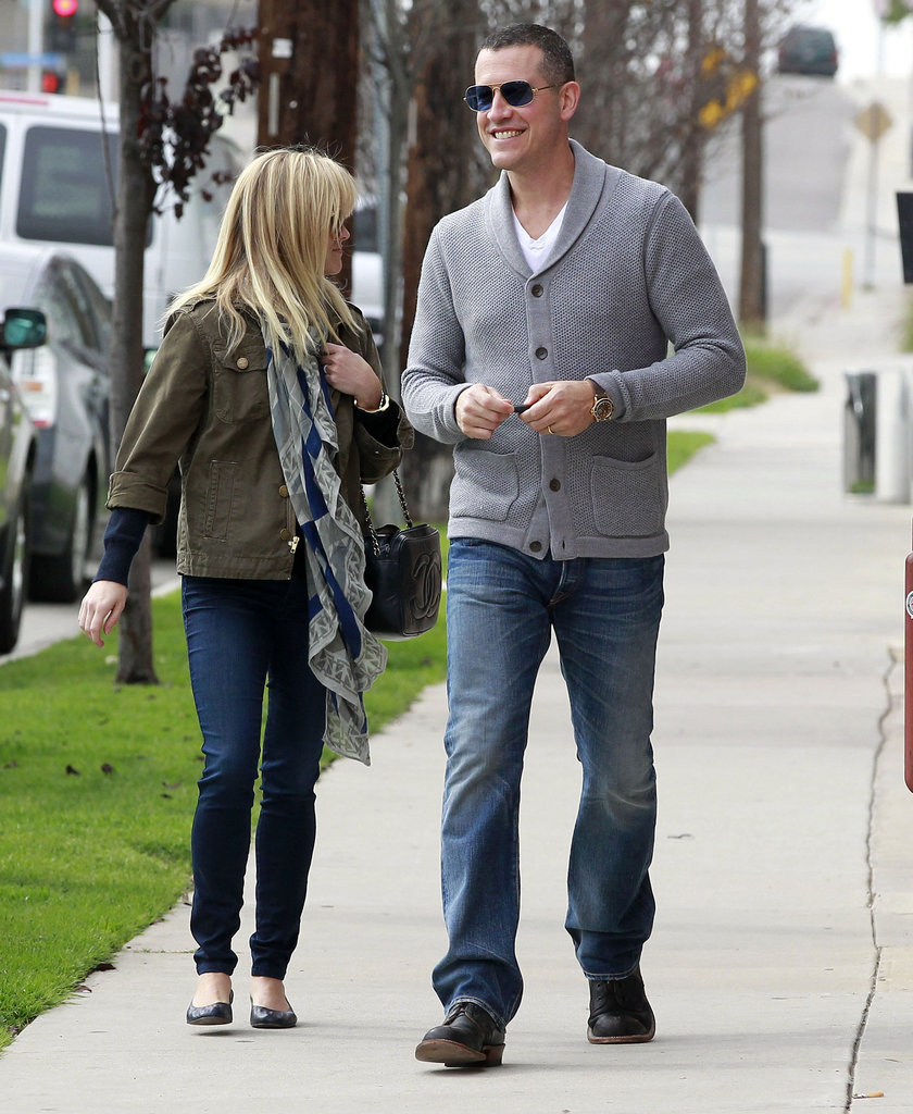 Reese Witherspoon and Jim Toth were warm in scarves and sweaters.