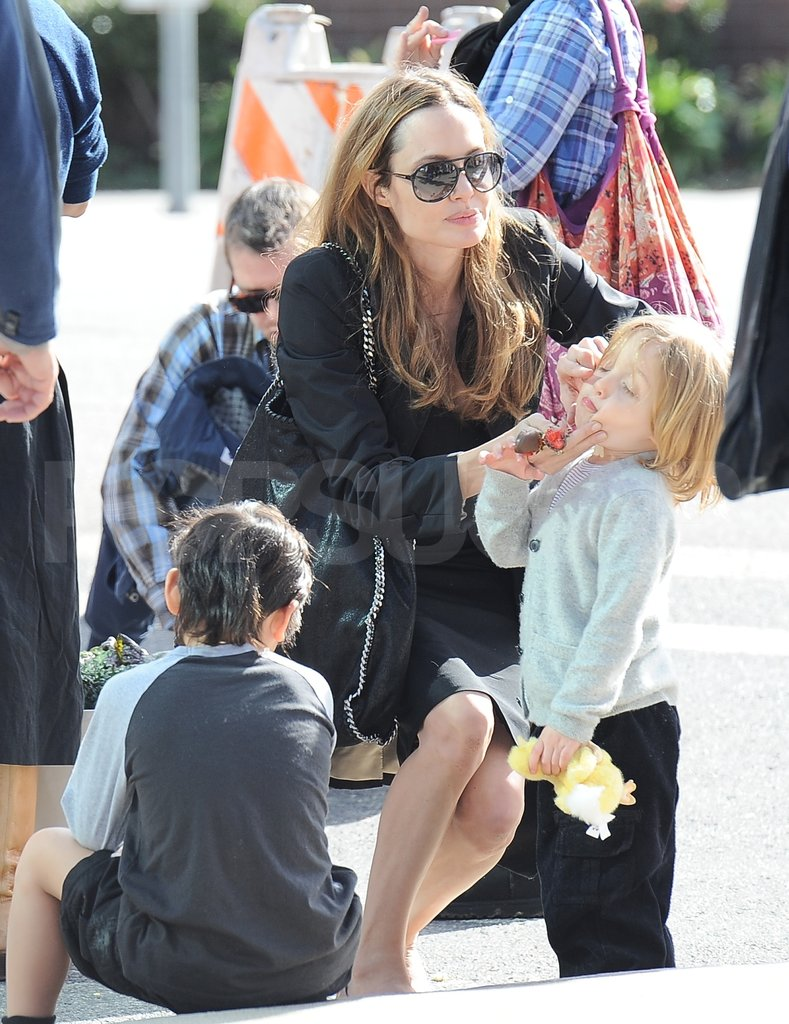 Angelina Jolie wiped something off of Knox Jolie-Pitt's face.
