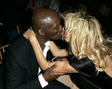 Heidi kisses fiancé at the time Seal at a 2005 Oscar party.