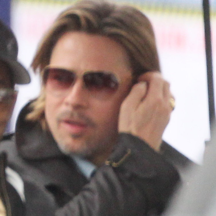 Brad Pitt pushed his long hair back behind his ears.