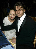 Johnny and Vanessa kept close at an Oscars afterparty in 2004.