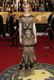 Mad Men star January Jones chose a black-and-gold Carolina Herrera gown for the 2011 awards.