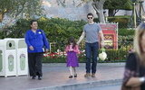 Tom Cruise and Suri Cruise had snacks at Disneyland.