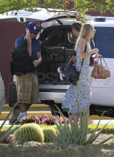 Leo wore a baseball hat and sunglasses while Erin stepped out in a floral dress.