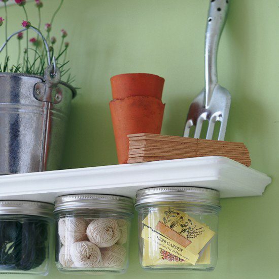 Attach mason jars to the bottom of shelves for an unexpected, extrafunctional storage space. Not only is it a practical way to collect your supplies, but it's also a sleek, eye-catching visual. Source