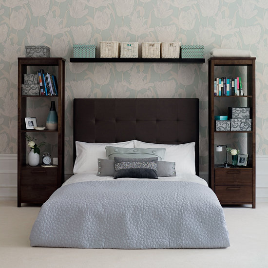 Forgo the traditional nightstand and choose tall bookshelves instead. They visually frame the bed, and open shelves offer the perfect opportunity to display your favorite books and keepsakes. Source