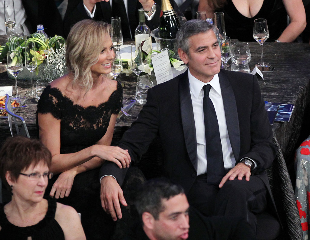 Stacy Keibler and George Clooney showed affection.
