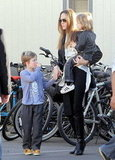 Angelina Jolie holding Knox and Shiloh after Circque du Soleil.