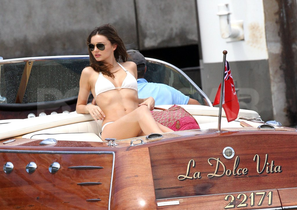 Miranda Kerr had her sunglasses on with a white bikini.