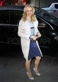 Rachel McAdams covered up her blue stripes with a white coat.