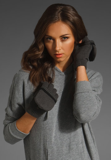 The added coziness of a fleece-lined mitten is a Winter wardrobe must; plus, the rounded mitten cover is cute, too.  Plush Fleece-Lined Texting Mittens in Gray/Black ($48)