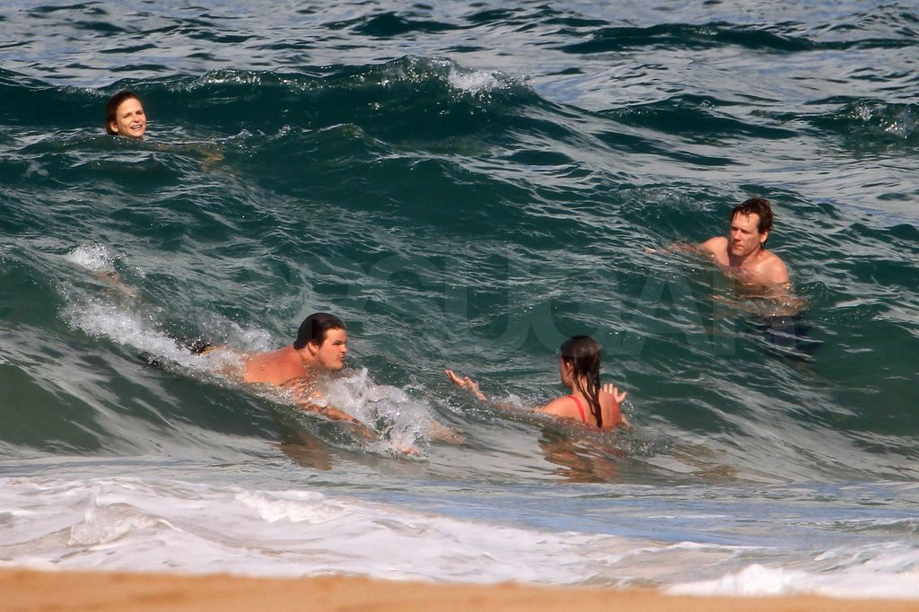 Kevin and Kyra swam in the ocean with their kids, Travis and Sosie.