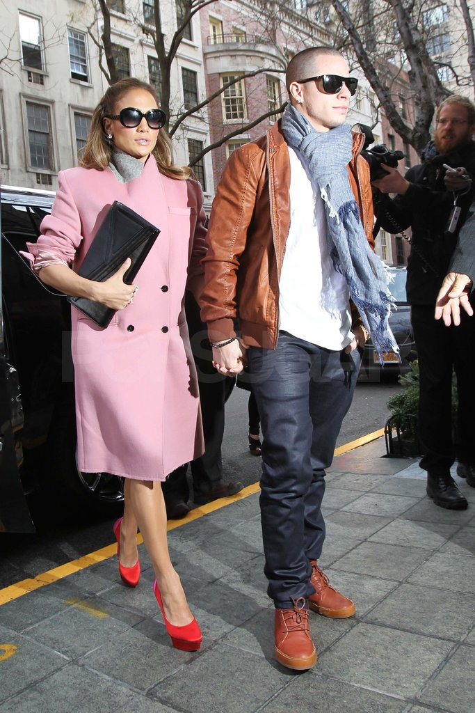 Jennifer Lopez in a pink coat with Casper.