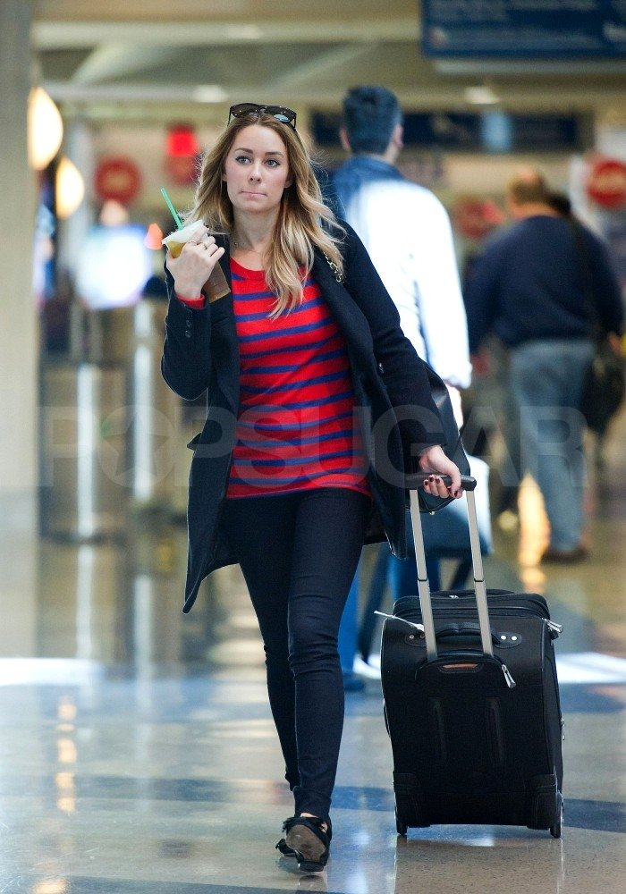 Lauren Conrad wheeled her luggage through LAX.