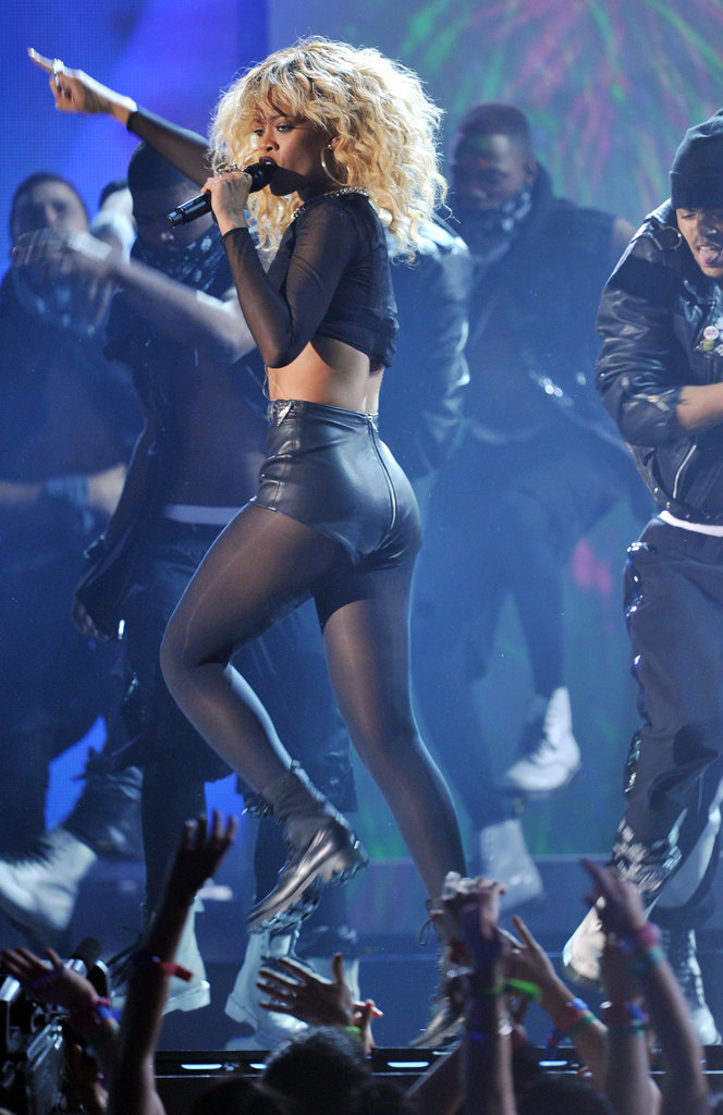 Rihanna wore sexy leather shorts on stage.