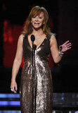 Reba McEntire hit the stage in a metallic gown.