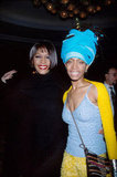 Whitney Houston and Erykah Badu smile at the 1999 Grammys.