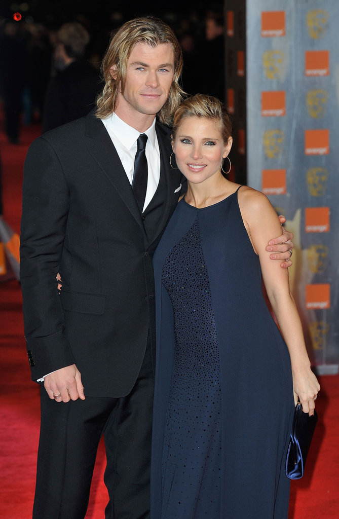 Chris Hemsworth keeps his pregnant wife, Elsa Pataky, close.