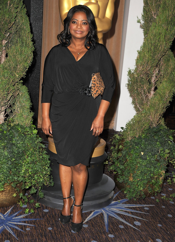 Octavia Spencer chose a soft black David Meister cocktail dress and black ankle-strap pumps. To accessorize, she spiced up her look with a leopard-print clutch.
