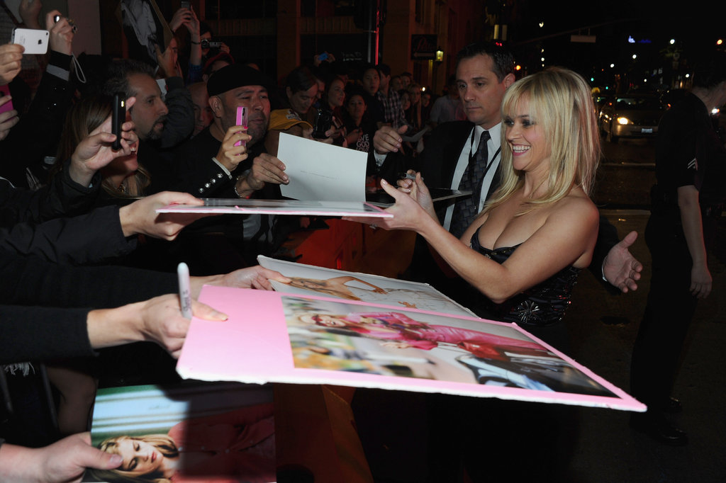 Reese Witherspoon signed autographs at the LA premiere of This Means War.