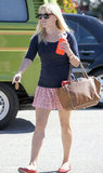 Reese Witherspoon in a printed skirt.