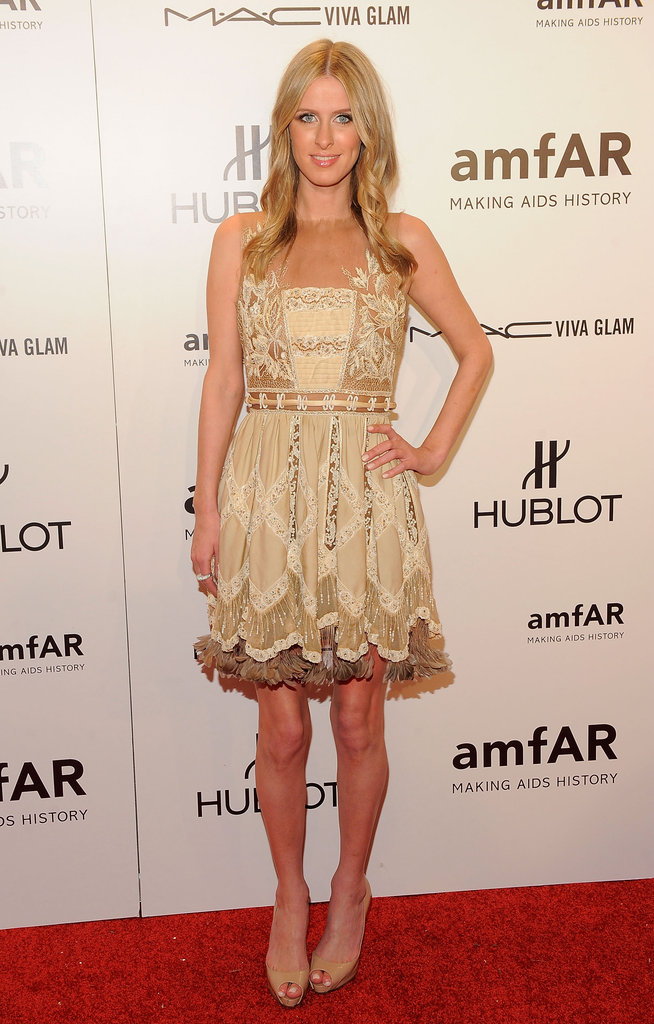 Nicky Hilton opted for a feminine lace cocktail dress and nude platform heels.