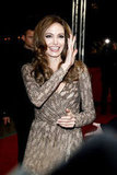 Angelina Jolie in a gold gown at the premiere of In the Land of Blood and Honey.