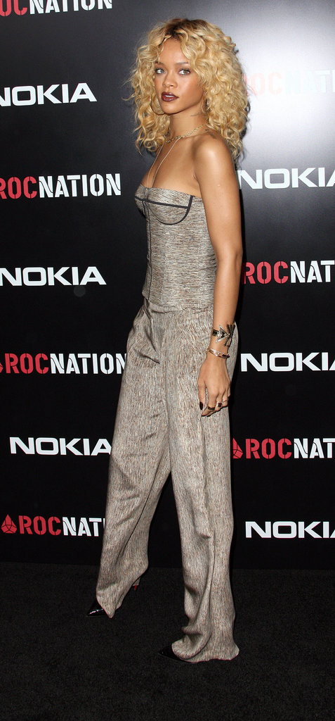 Wearing a bustier jumpsuit at a pre-Grammy party in LA.