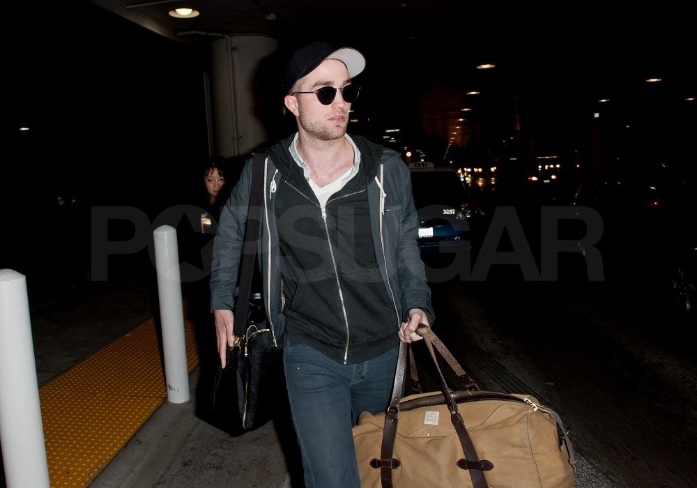 Rob quickly darted to his car waiting outside LAX.