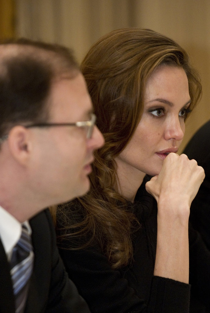 Angelina Jolie listened during a conference on sexual violence and child slavery.