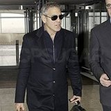 George Clooney wore sunglasses at Heathrow.