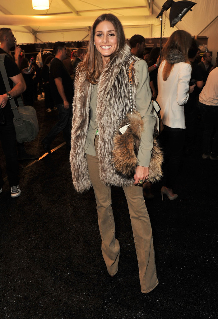 Olivia opted for a tonal look here, pairing the same statement fur vest with camel-hued pants, a peplum blazer, and a fur bag at the Rebecca Taylor runway show.