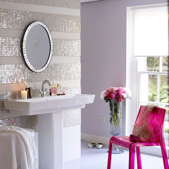 A side chair can add instant pink to a bathroom — and also can easily be removed if you feel the need for a change. Source