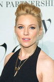 Sienna Miller wore her hair up.