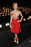 Ahna O'Reilly dressed up in Naeem Khan's floral-adorned frock for the designer's Fall show.