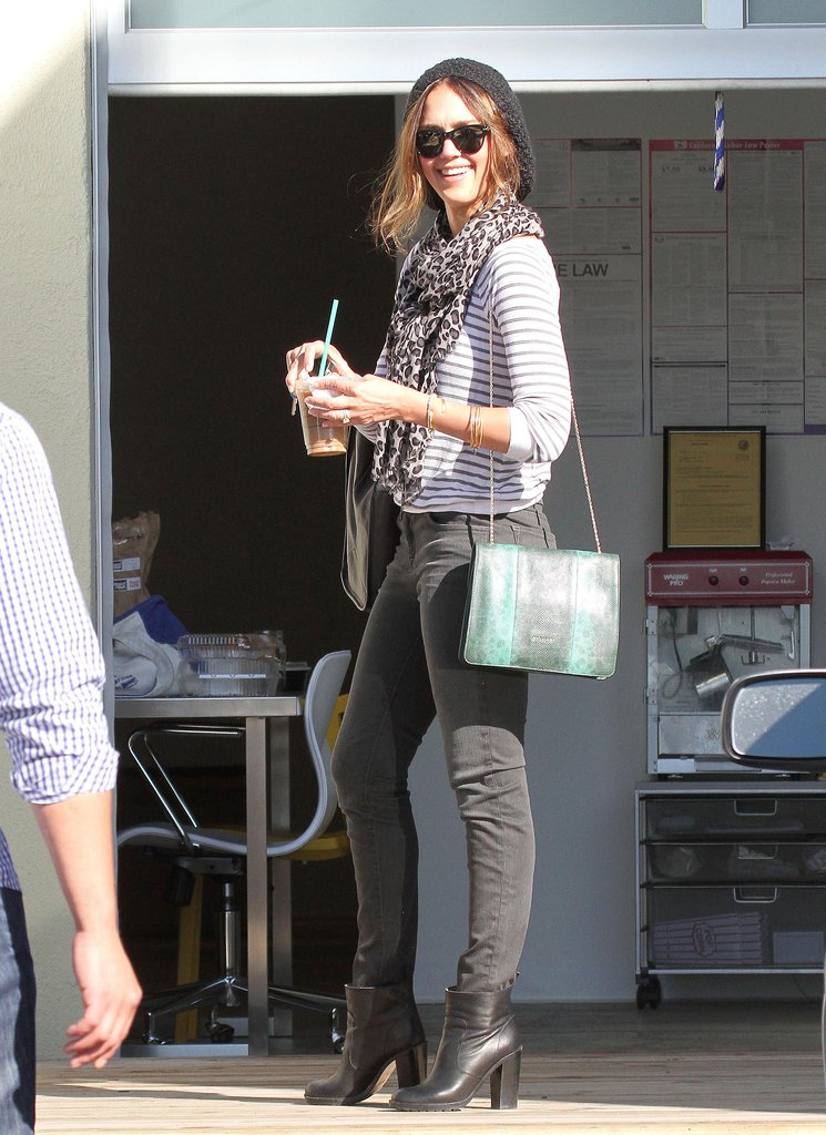 Jessica Alba also owns an emerald Bulgari chain-strap bag, though she wore it in a more casual way with a beanie, stripes, and a leopard scarf. Shop her look here.
