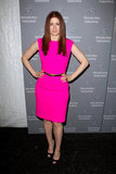 Debra Messing wore a hot pink Michael Kors sheath at the brand's runway show.