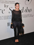 Olivia attended the W magazine soiree in a sheer peplum top, black trousers, and feathered clutch.