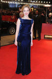Holliday posed for the cameras in a bright blue dress.