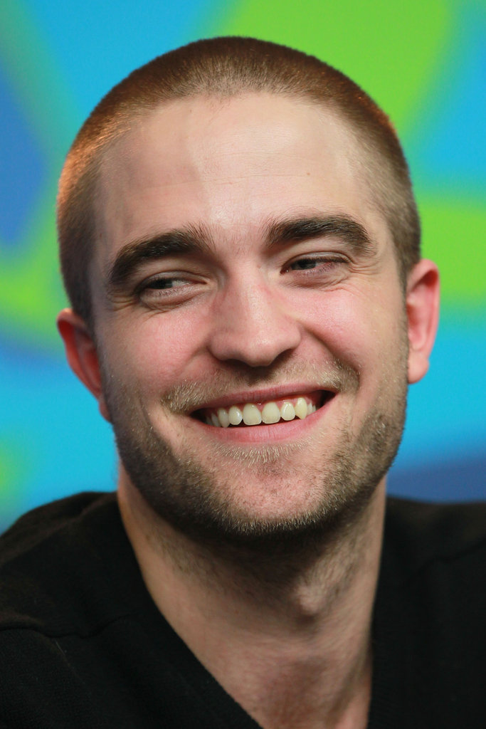 Rob looked adorable as he gave a big smile at the Bel Ami Press Conference.