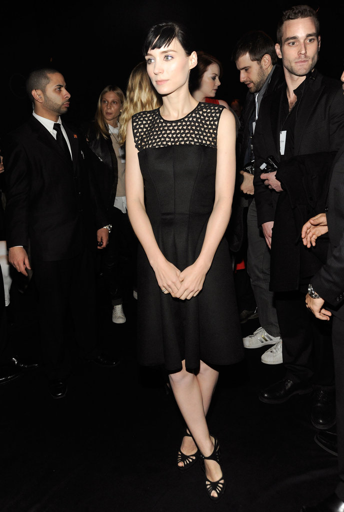 Rooney Mara was the picture of all-black chic at Calvin Klein's Fall '12 runway show. She wore the designer's woven-detail LBD with a sweet pair of strappy heels.