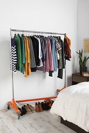 If you're lacking closet space in tight quarters, an Industrial Garment Rack ($100) with the right hint of color can take this idea from drab to stylish.