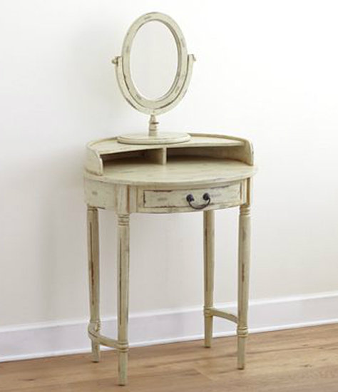 Marked down from $250, this Christa Vanity Table with Mirror ($130) looks like an adorable flea market score.