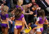 David Beckham, Cruz Beckham, Romeo Beckham, and Brooklyn Beckham chatted before Lakers cheerleaders.