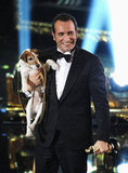 The Artist star Jean Dujardin held his costar Uggie the Dog while accepting the best picture award at the 2012 Oscars.